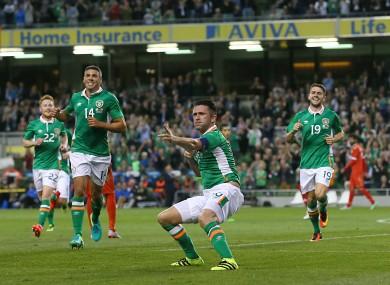 Robbie Keane celebrates scoring his 68th international goal.
