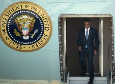 Obama departs Air Force one at Hangzhou airport.