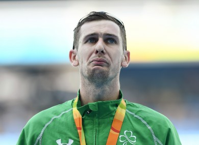 McKillop holds back the tears on the podium.
