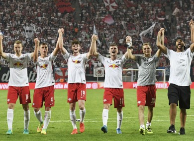 The RB Leipzig players celebrate their win over Borussia Dortmund.