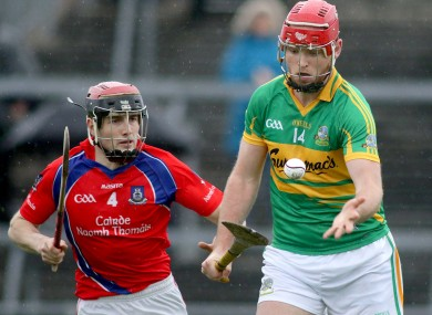 Gort's Michael Mullins with Cathal Burke of St. Thomas.