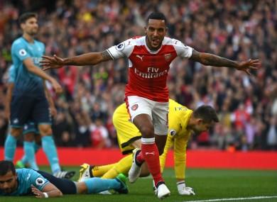 Arsenal forward Theo Walcott celebrates scoring against Swansea City.