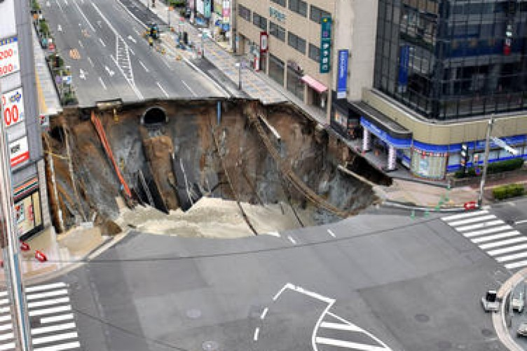 9c8ab6cbe2f Japanese city street swallowed by giant sinkhole · TheJournal.ie