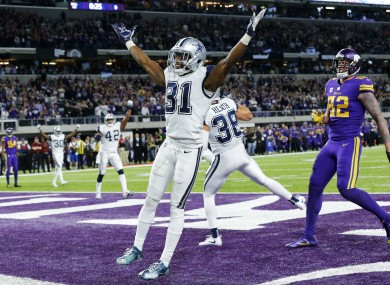 Byron Jones leads the Cowboys' celebrations after breaking up a pass in the endzone.