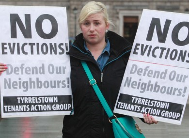 A resident of Tyrrelstown protesting outside Leinster House
