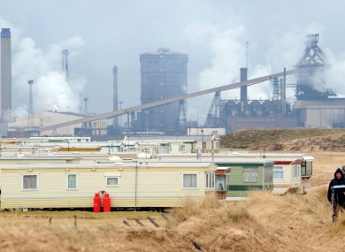 File photo of a view from Redcar beach showing the Corus Plant in Redcar in the north of England which has mostly closed down.