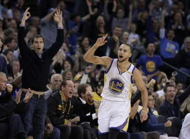 Steph Curry celebrates scoring during the first half.