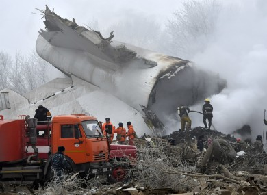 Kyrgyz Emergency Ministry officials work among remains of a crashed Turkish Boeing 747 cargo plane