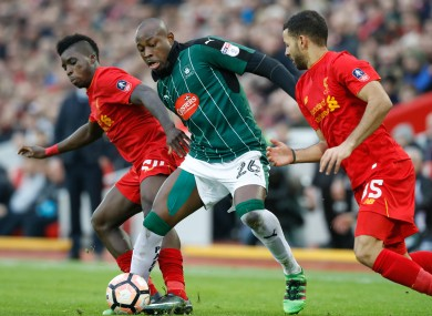 Liverpool's Sheyi Ojo (left) battles for the ball with Plymouth Argyle's Paul Arnold Garita (centre) during the Emirates FA Cup, Third Round match at Anfield.