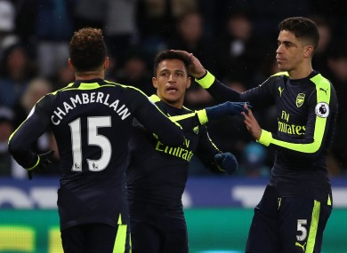Arsenal's Alexis Sanchez (centre) celebrates scoring his side's fourth goal of the game.