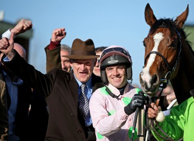Jockey Ruby Walsh celebrates Faugheen's 2015 Champion Hurdle success with winning trainer Willie Mullins.