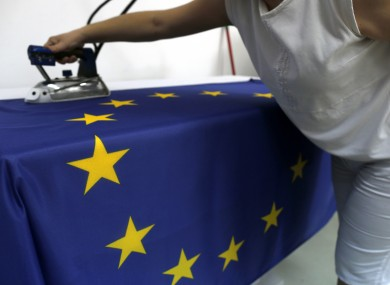 A seamstress works on an EU flag in Belgrade.