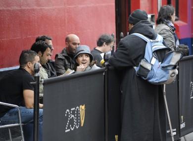 A beggar pleads for money in Dublin.