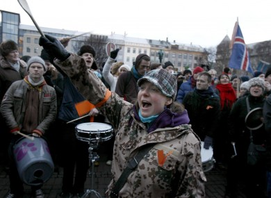 People protest in Reykjavik over the government's handling of the financial crisis.