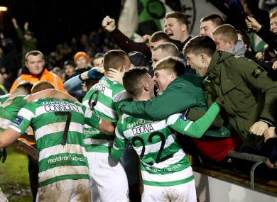 The Rovers players celebrate Michael O'Connor's goal with fans.