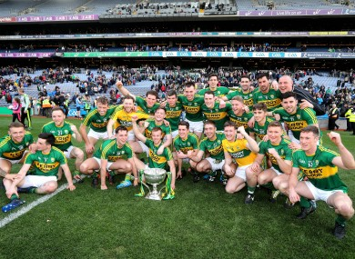 Kerry players celebrate yesterday's league final victory.