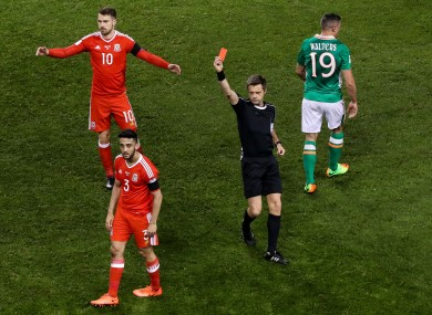 Wales defender Neil Taylor is sent off by referee Nicola Rizzoli.