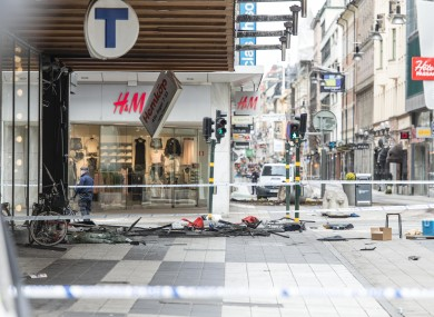 The site of a violent attack is blocked by the police in Stockholm, Sweden.