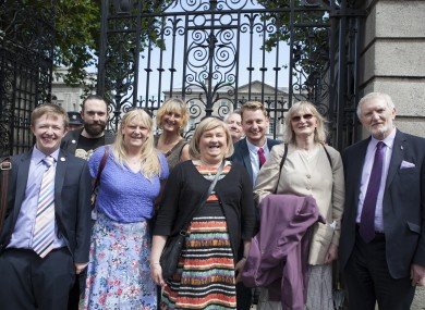 Members of TENI celebrating the passing of the 2015 bill outside the Dáil.