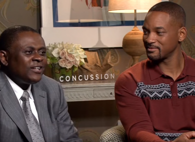 Dr. Bennet Omalu and Will Smith during the promotional tour for Concussion.