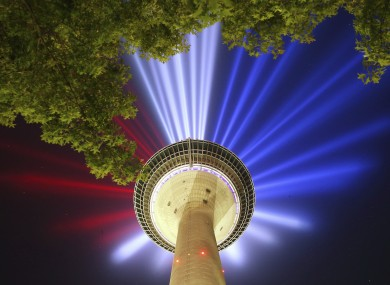 The blue, white and red of the French flag is projected from the Rheinturm in Dusseldorf: the 2017 Tour de France starts there on Saturday.