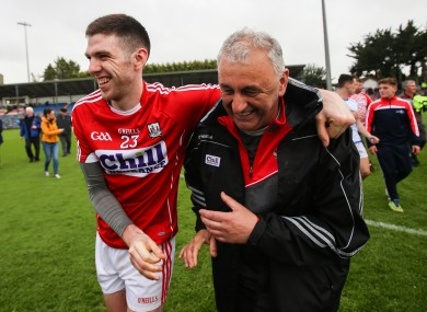 Luke Connolly and Peadar Healy after Cork's victory.