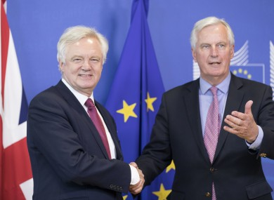 The UK's chief negotiator David Davis shakes hands with his EU counterpart Michel Barnier today.