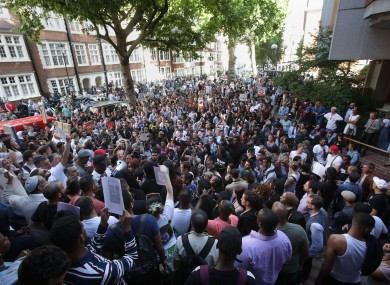 Protesters outside Kensington town hall in west London, the headquarters of the Royal Borough of Kensington and Chelsea,
