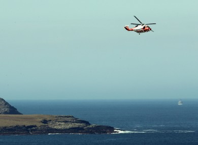 An Irish Coastguard helicopter searching along the coastline near Blacksod, Co Mayo, earlier this year.