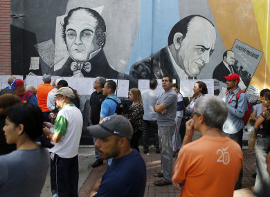 People line-up to enter to a poll station during the election for a constitutional assembly in Caracas, Venezuela.