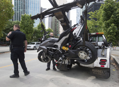 The Ducati motorcycle is taken away from the scene.