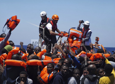 File photo of rescuers of SOS Mediterranée distributing lifejackets to migrants in distress on the Mediterranean Sea.