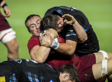 Glasgow's Ryan Wilson and Peter Horne tackle Tommy O'Donnell of Munster.