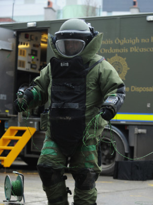 An Army Bomb Disposal member makes an approach to an explosive device
