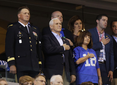 Vice President Mike Pence stands during the playing of the national anthem before an NFL football game.