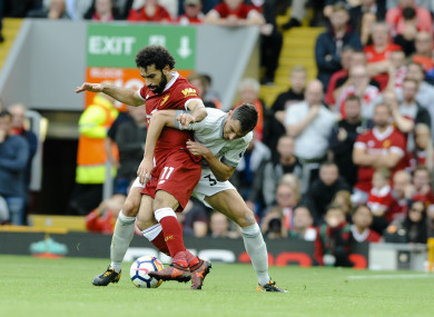 Liverpool's Mohamed Salah, left, and Manchester United's Matteo Darmian, right, battle for the ball.