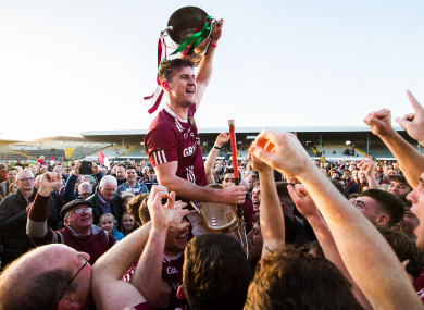 Dicksboro's Ollie Walsh celebrates after the game with the trophy.