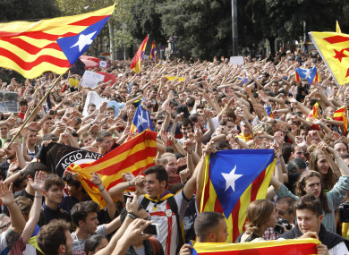 Catalan independists gathered Playa de Catalunya in Barcelona, Spain, yesterday to celebrate the result of the referendum.