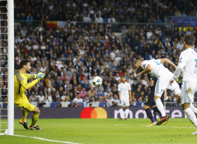 Real Madrid's Karim Benzema, second right, looses an opportunity to score against Tottenham goalkeeper Hugo Lloris.
