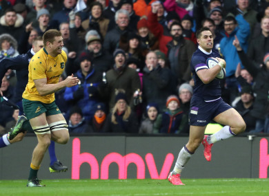 Scotland's Sean Maitland runs away to score his side's fifth try.