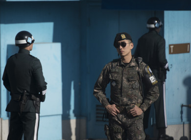 South Korean soldiers stand guard in the border village of Panmunjom between South and North Korea at the Demilitarized Zone (DMZ)
