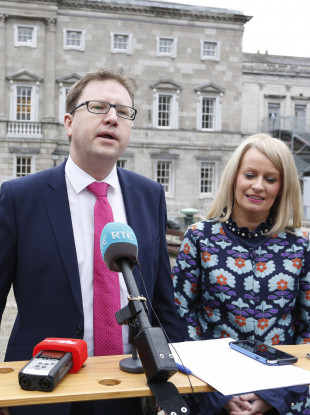 Fianna Fáil TDs James Lawless and Niamh Smyth speaking to the media on the plinth at Leinster House today.