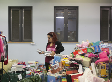 Volunteers sort out toys in Saint Vincent De Pauls Warehouse in Dublin