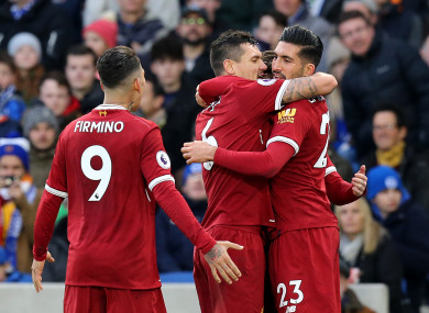 Emre Can celebrates scoring Liverpool's first goal with Dejan Lovren and Roberto Firmino.