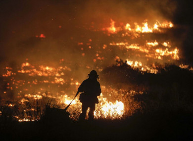 A firefighter along West Lilac Road in Bonsall, California