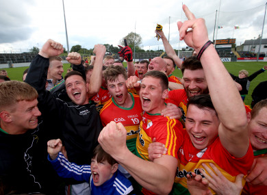 Carlow players celebrate after their win over Wexford.