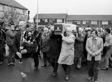 A piper leads the funeral procession from Patrick Kelly's home on the Lisnahull Estate in Dungannon .
