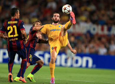 Cillian Sheridan, then of Apoel Nicosia, controls the ball despite the attentions of Barcelona's Sergi Samper during their 2014 Champions League game at the Nou Camp.