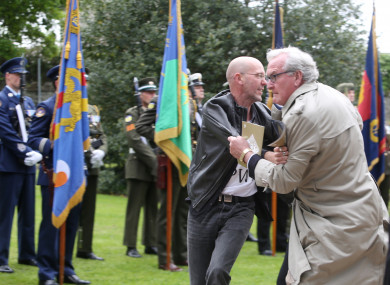 Canadian Ambassador Kevin Vickers tackling Brian Murphy at the event in 2016