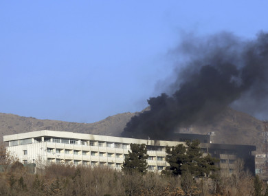 Black smoke rises from the Intercontinental Hotel.